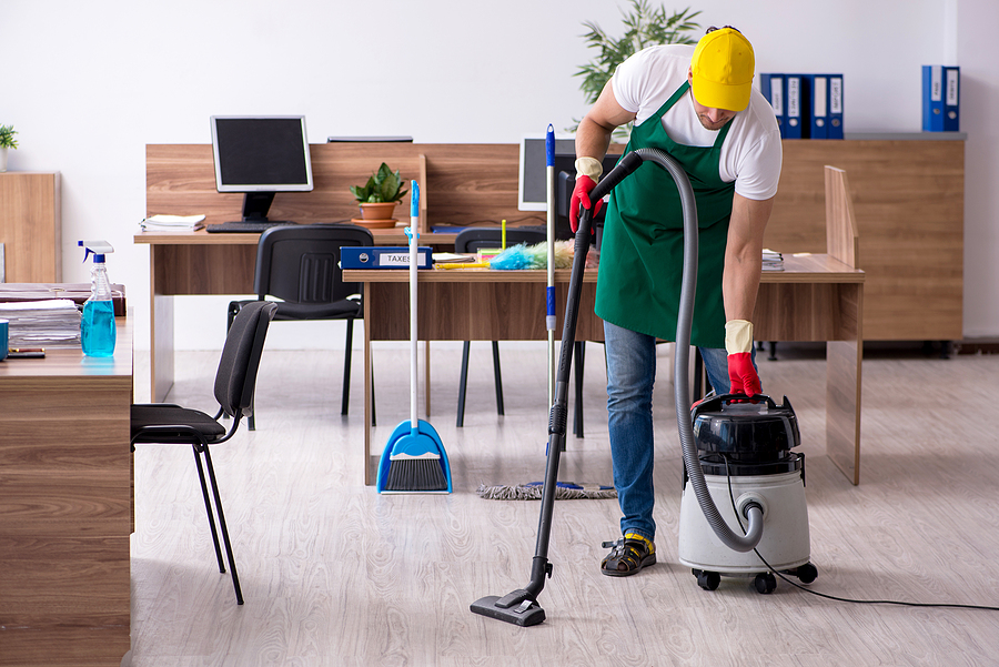 bigstock-Young-male-contractor-cleaning-390676523