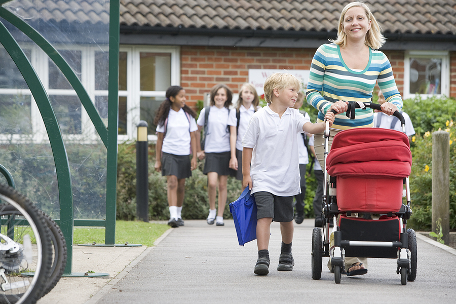 bigstock-Woman-Leaving-School-With-Chil-3915925