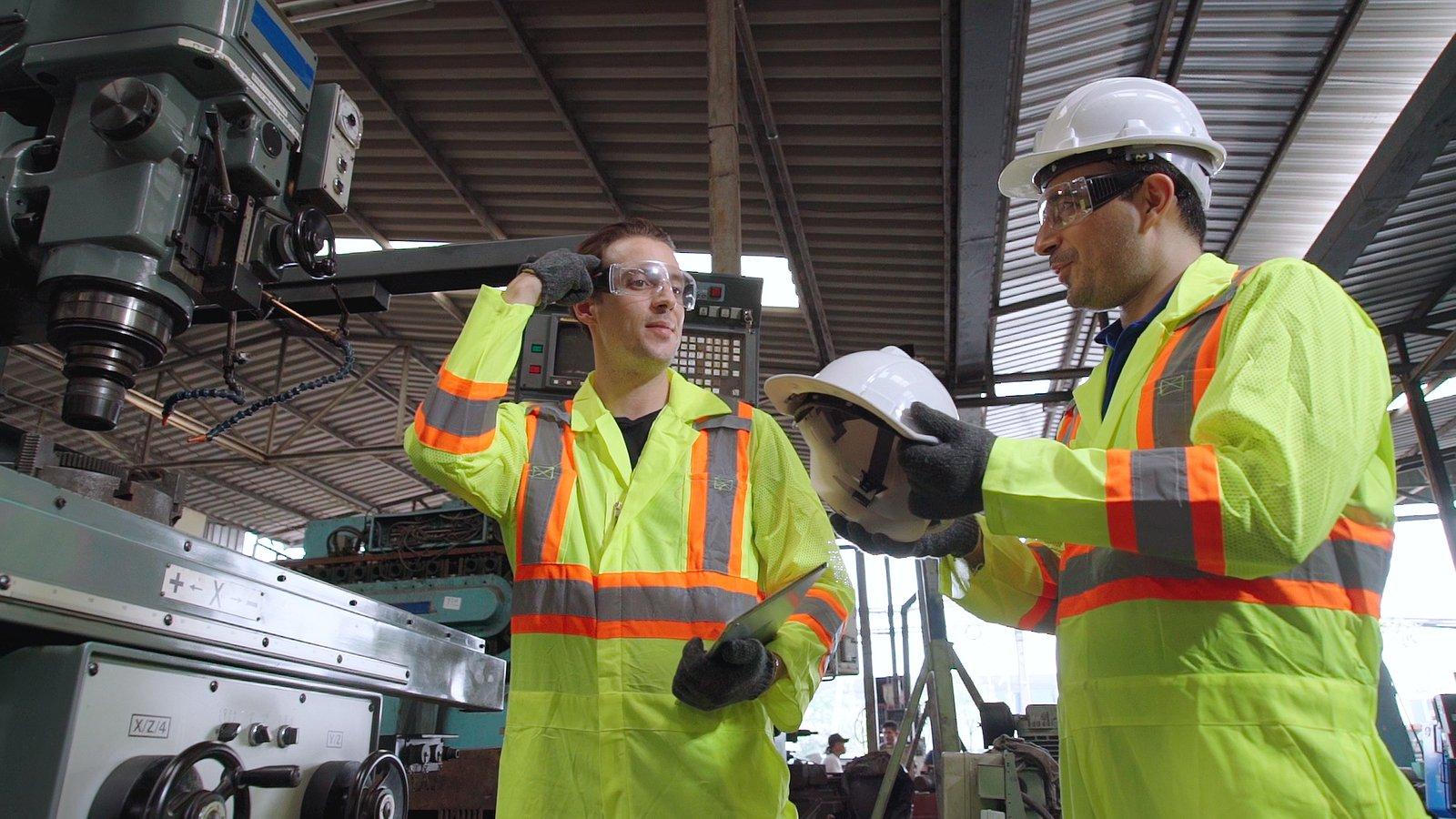 bigstock-Factory-Worker-Warn-Coworker-A-387177118 (2)